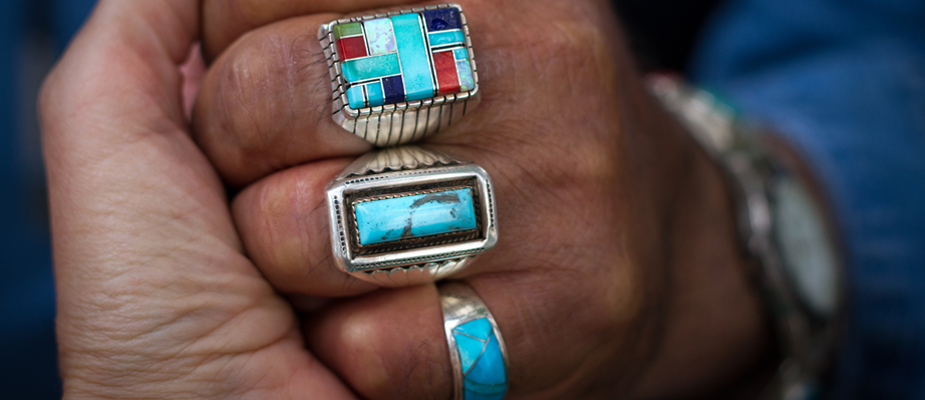 turquoise inlay rings on a hand
