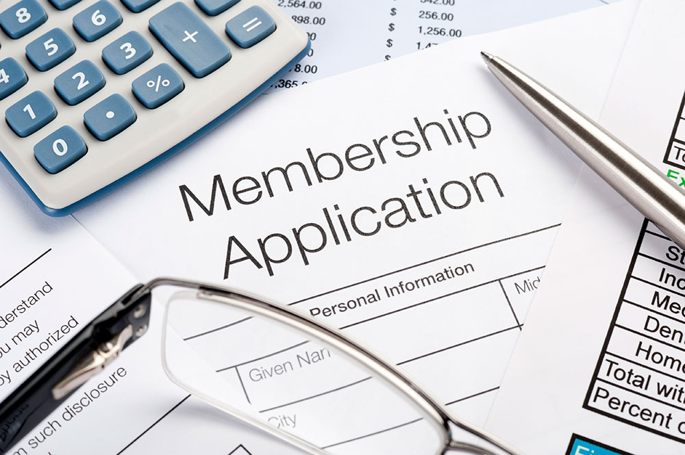 Membership application Form with pen and calculator