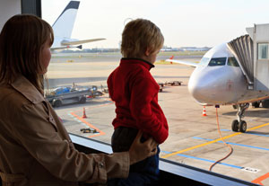 child with mother at airport