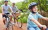 young couple with son riding bikes