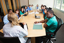 Doctors sitting around conference table