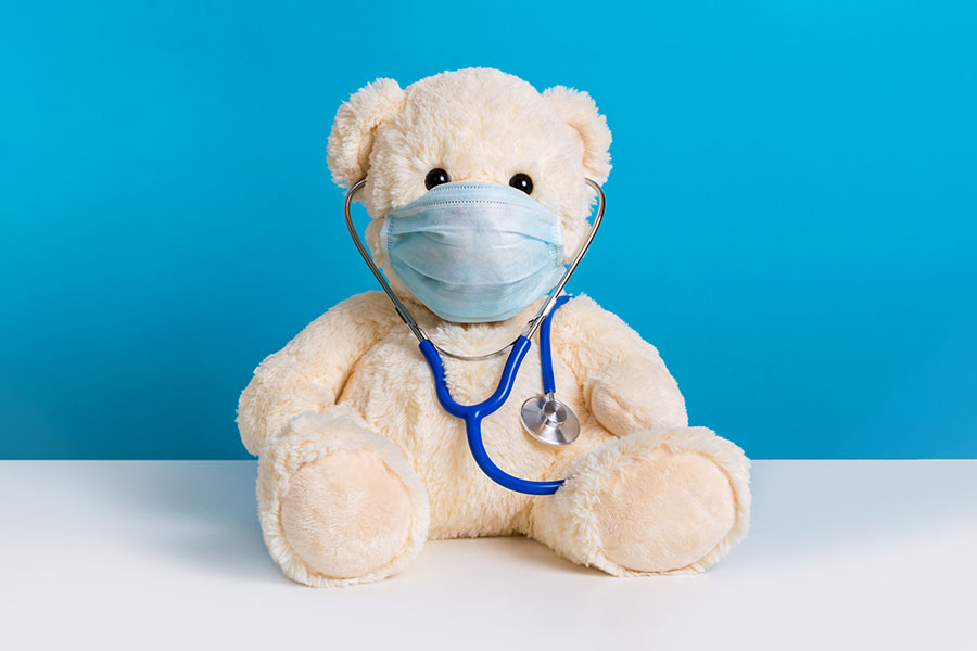Teddy bear with protective medical mask and stethoscope