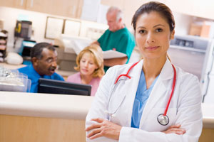 female doctor standing in front of health care professionals