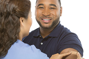health care professional immunizing man