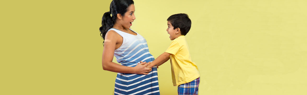 Pregnant woman with her son.