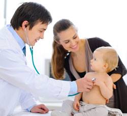 doctor with baby and mother