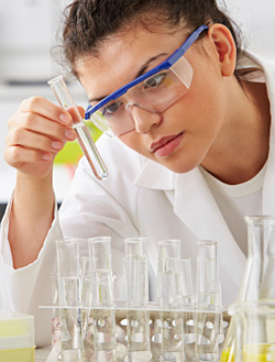 lab scientist working with test tubes