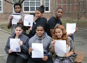 Group of students holding letters written to CDC