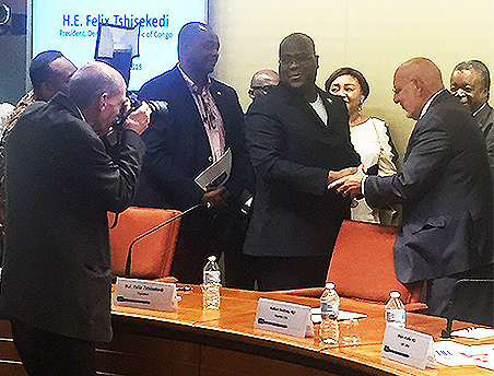Jim Gathany snaps a photo of CDC Director Dr. Robert Redfield shaking hands with Felix Tshisekedi, the president of the Democratic Republic of the Congo