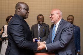CDC Director Dr. Robert Redfield shaking hands with Felix Tshisekedi, the president of the Democratic Republic of the Congo