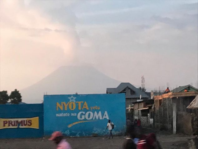 Readily visible throughout Goma, the Nyiragongo volcano pours smoke into the skies north of the city.