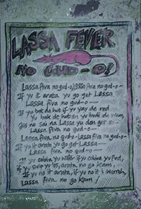 sign reading Lassa Fever no gud-o! Lassa fiva no gud-0, lassa fiva no gud-o if yu it arata yu go get lassa lassa fiva no gud-o if yu trot de hut if yu yay de red yu bak de hut en yu don get so lassa fiva no gud o lassa fiva no gud o