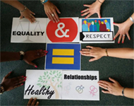 Diverse hands around piece of paper with the phrase equality and respect equal healthy relationships.