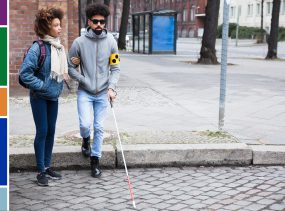 woman holding boyfriend's arm who is blind