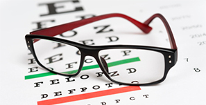 eyeglasses on an eye exam chart