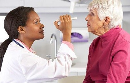 Doctor giving eye exam to patient