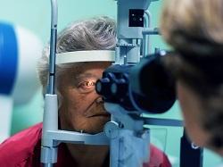 Older woman receiving an eye exam