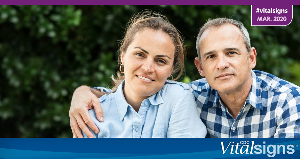 Photo of a man and woman that could be in their early 50s, when it's time to get screened for colorectal cancer. The man's arm is around the woman's shoulder.