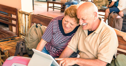 Two adults using an iPad