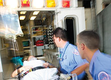 EMTs loading patient into ambulance