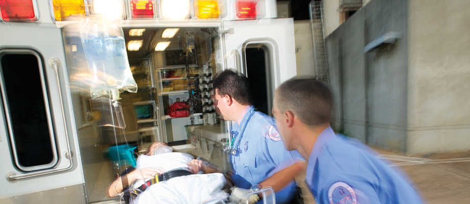 Paramedics with patient in an ambulance
