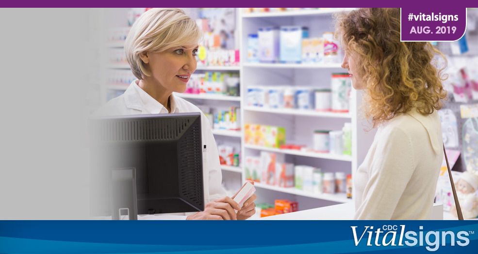 A pharmacist talks with a patient about a prescription.