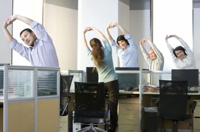 Employees exercising in an office setting