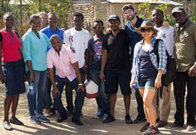 EIS officer Cuc Tran (third from the right) and OC Hurbert fellow Maxwell Kligerman (behind her) with the team in Haiti.