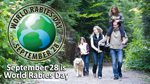 World Rabies Day logo with family walking with dog.