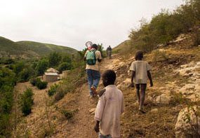 Typical Haitian countryside. Team of educators hiking to reach remote villages.