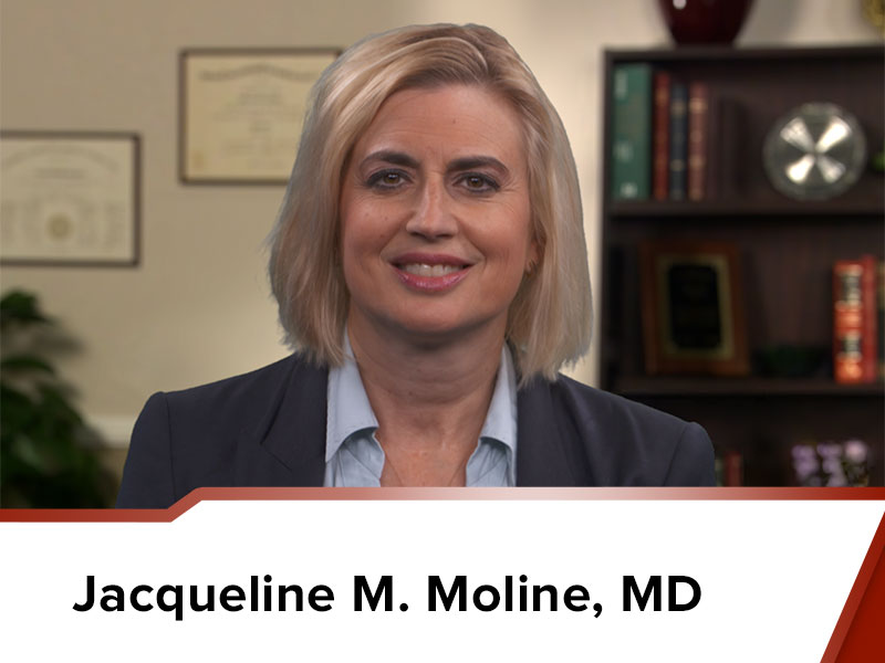 Dr. Jacqueline M. Moline MD facing the camera in an office environment