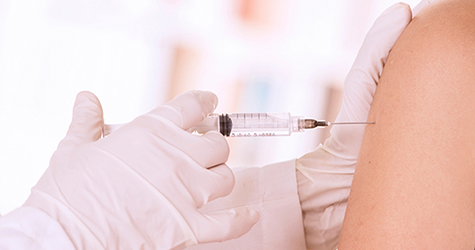 Person getting a vaccine in the arm