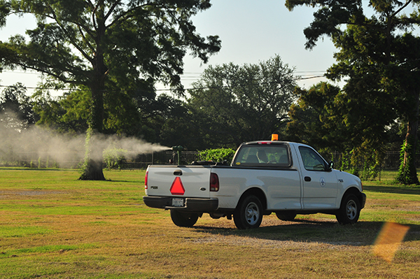 A pickup truck spraying insecticide