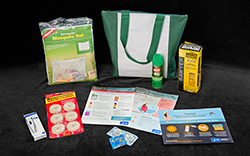 Zika virus prevention kit.  Items include a mosquito net, insect repellant, condoms, and brochures & posters on zika virus