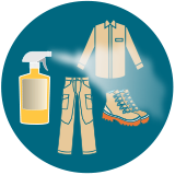clothing and gear being sprayed with insect repellent